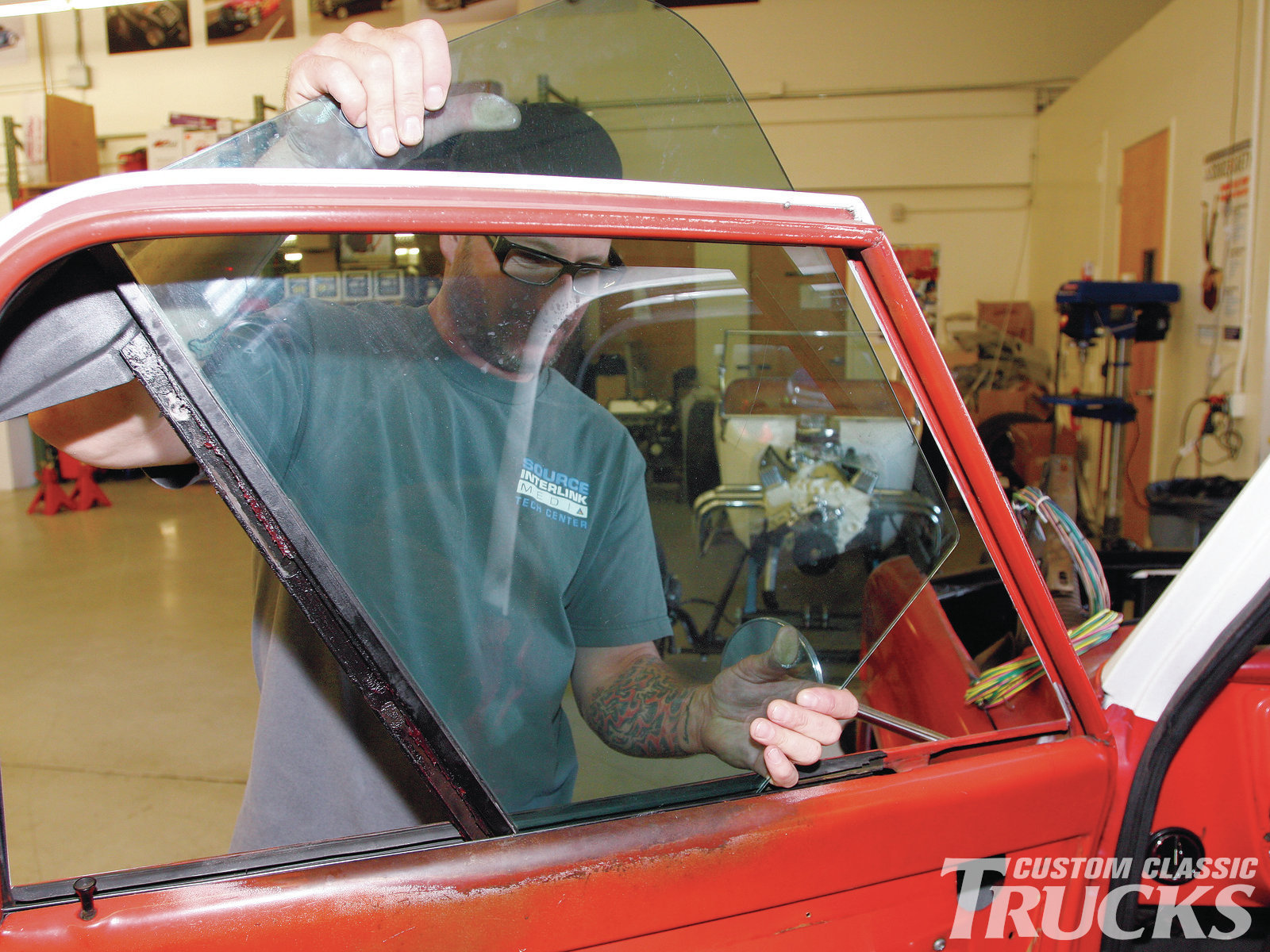 12. Once the vent window assembly is out of the way, the door glass can be removed to make swapping the regulators much easier.