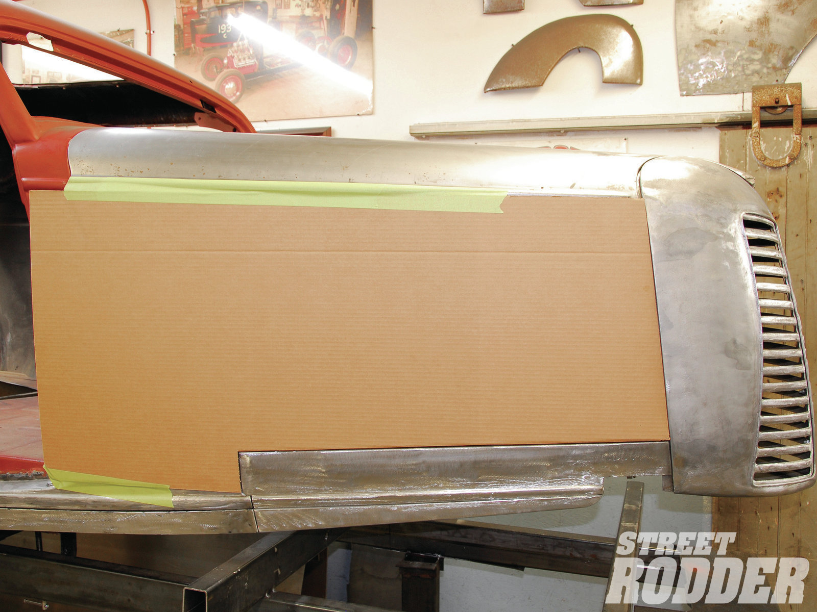 7| Using 2-inch masking tape, the template was then secured in place to begin trimming the rear section.