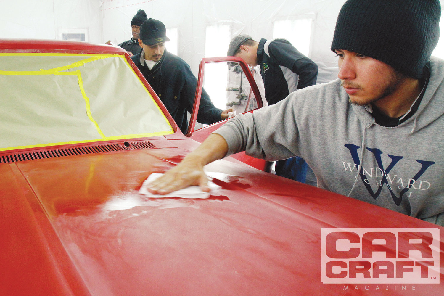 [7] After wet sanding, we thoroughly washed the car. The sanding residue will dry to a fine powder that can get churned up and land in our new paint job, making it a dusty mess. After washing, we began masking the car before pushing it into the spray booth.