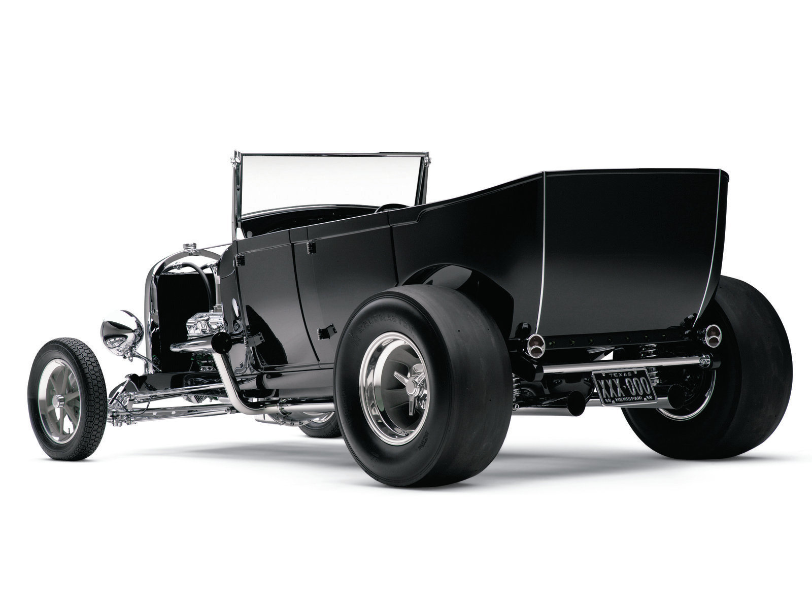 New wheel tubs and inner skins for the quarter-panels are just a couple of the metal fab'ing features Joe incorporated into his tub. The rod rolls on M&H-wrapped 16x10 magnesium Halibrands and 15x4 12-spoke wheels shod in Michelin 135-15 rubber.