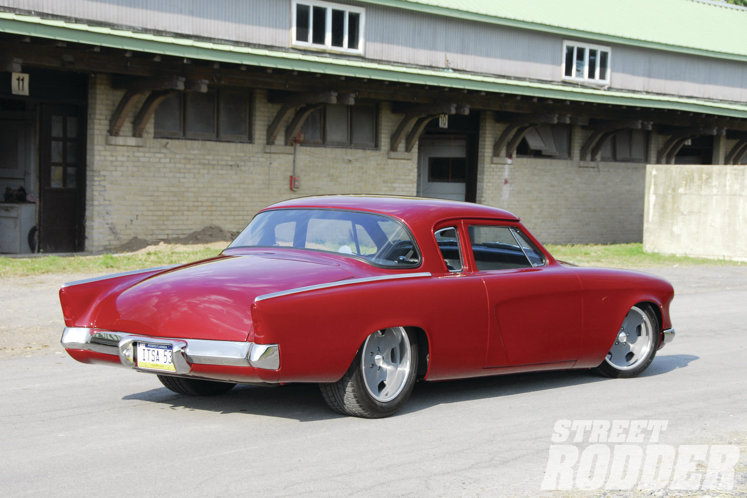 Coated in PPG Inferno Red gloss, accents like the pinched and tucked bumpers, extended rear quarters, and dazzling brightwork from Jon Wright's Custom Chrome Plating make it a standout.