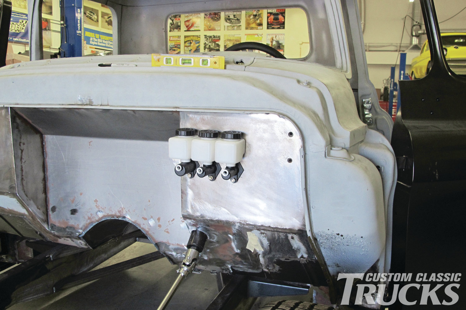 1. Jason Scudellari modified his 1956 Chevy pickup's firewall to accommodate an LS engine that will be slid back in the chassis, Wilwood master cylinders and swing pedals, and a Flaming River steering column.