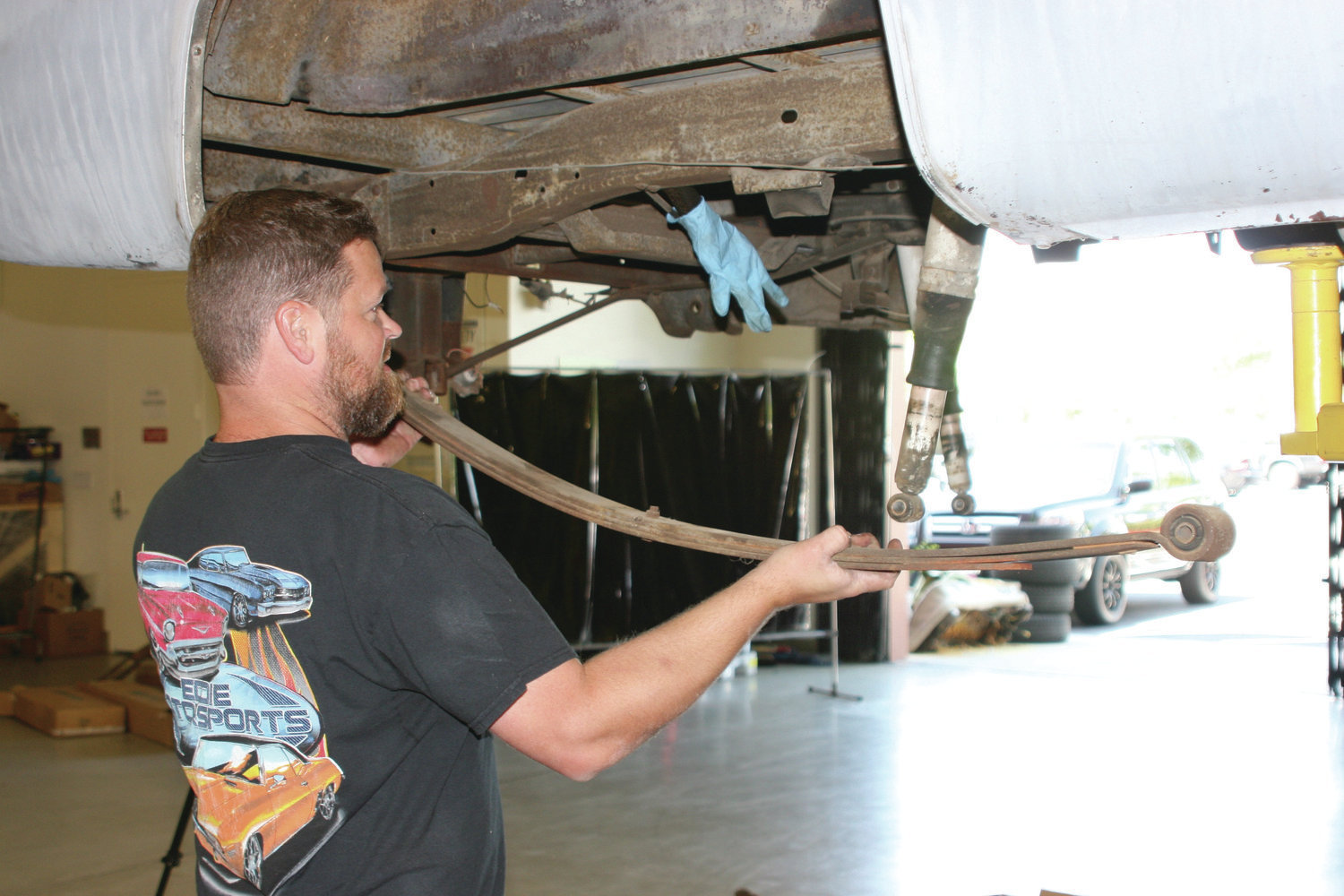 1. We first supported the truck on a rack and making sure it was safe to work under. Next we removed the rear axle and leaf springs, but I won't bore you guys with those details.