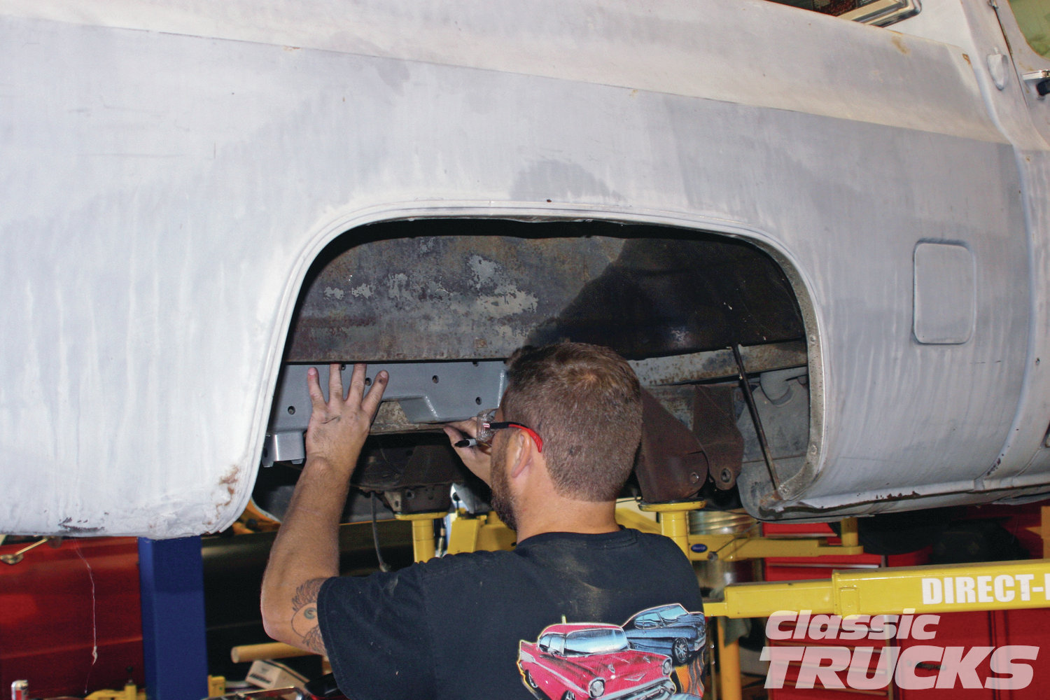 3. Next the passenger and driver side C-notch were used as templates to measure where the stock frame needed to be cut.