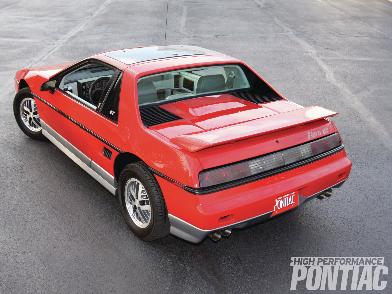 The rear end of the Fiero GT was similar to the standard version, with the exceptions of the rear spoiler, which replaced the luggage rack and the engine cover, which was body-colored and slightly bubbled for engine clearance.
