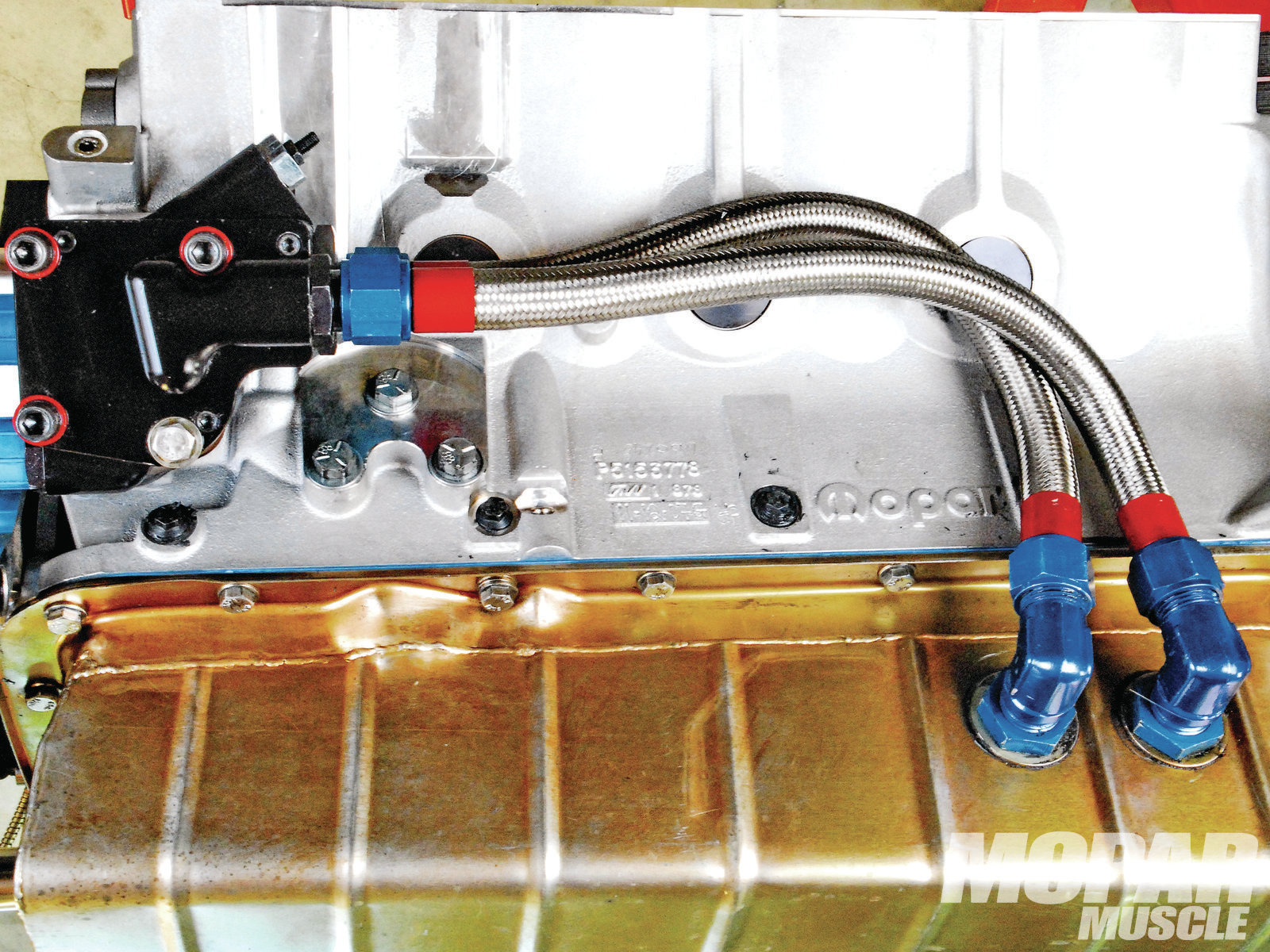 The oiling system is a 10-quart pan with a dual line and a swing-arm pickup, feeding a high-volume Titan pump, and a remote two-quart Wix oil filter. Here's a tip for you: If you pay attention to how you route the oil lines, you can consistently keep oil in the pump. That way, there are no dry starts.