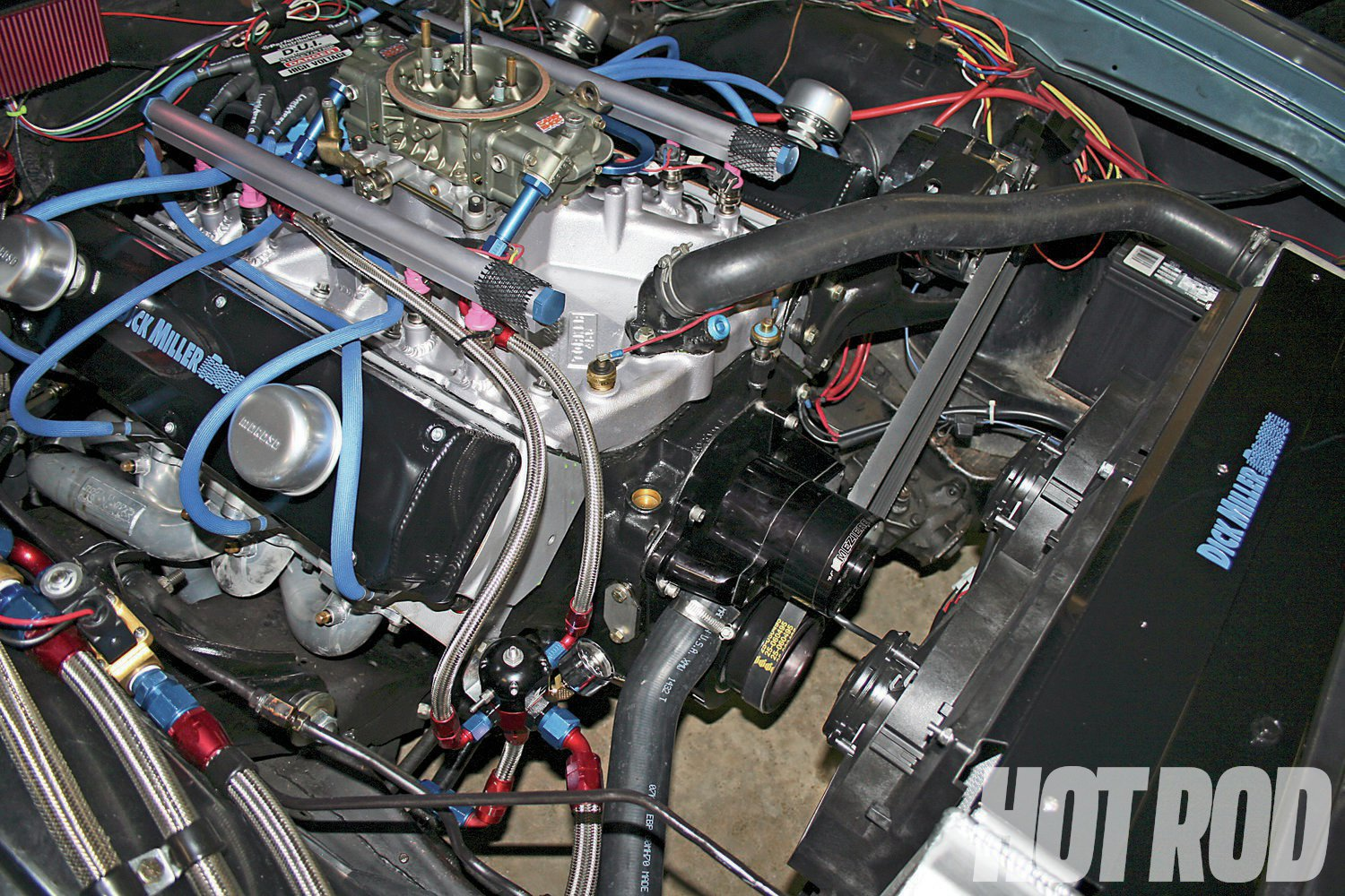 "As seen on Dick Miller's own '70 W31 Cutlass now running a 735hp big-block Olds, the DMR drives uses stock brackets and accessories. This variant drives only the alternator 20 percent under to clear a Meziere electric water pump. With a Be Cool radiator and twin electric fans, Miller says the car ""makes back-to-back 6-second runs and never gets over 180 degrees."""