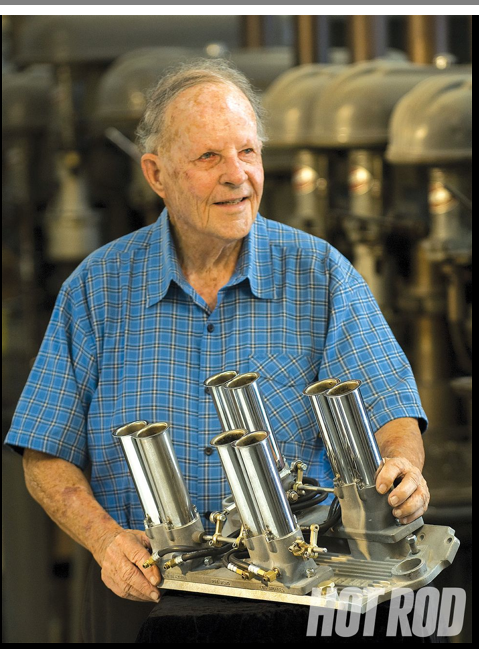 Stuart Hilborn seen here with an intake manifold fit with an injection system that bares his name.