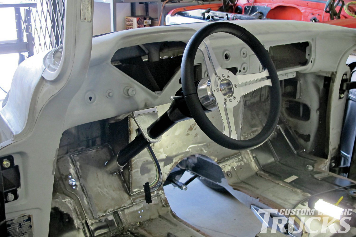7. To double-check the angle of the column, a test fit was made. Note the swinging dash mount and the black Flaming River Navigator leather-wrapped steering wheel (part number FR20164BK) that mounts with an adapter (part number FR20119BA).