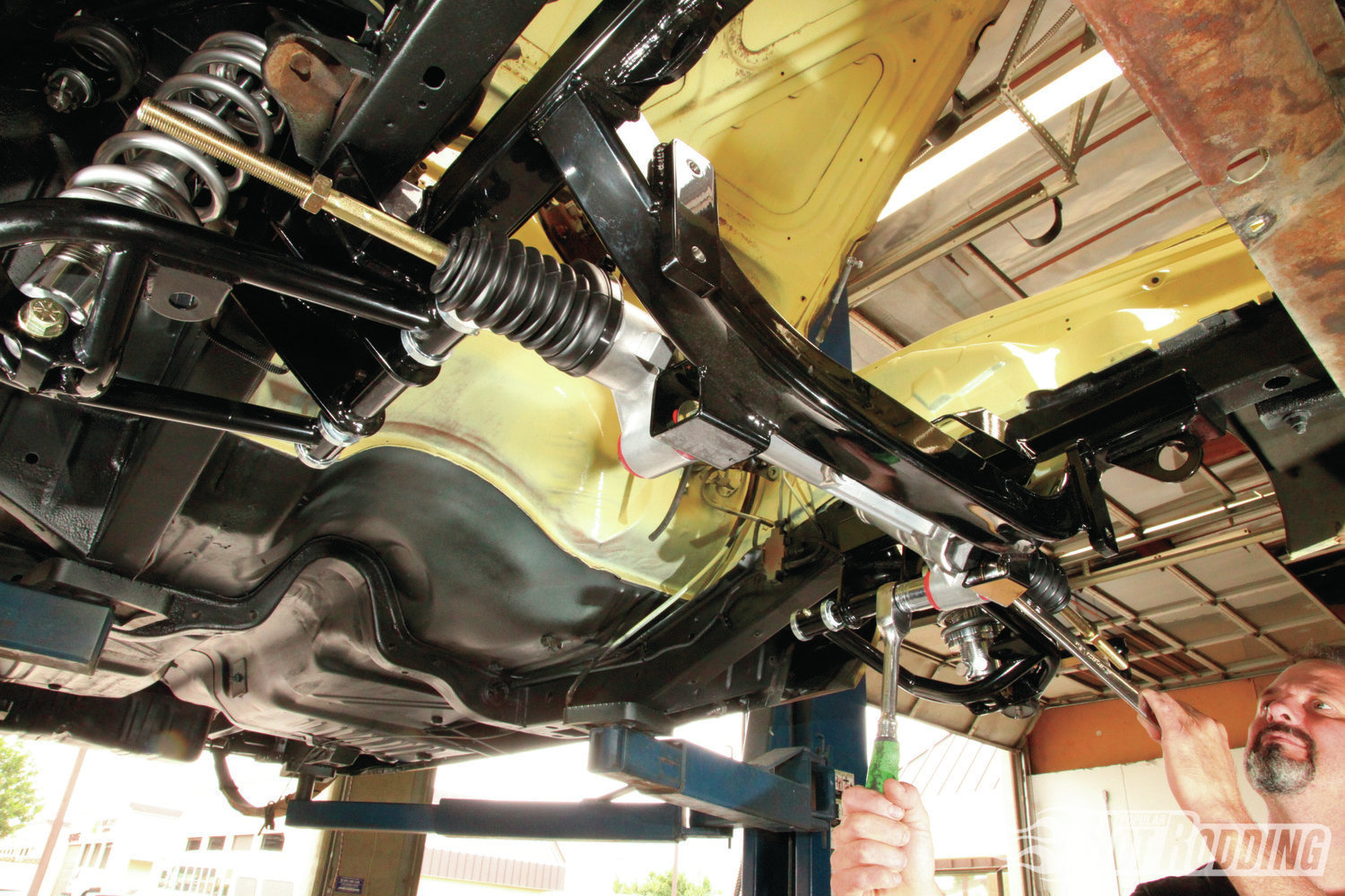 12. Install the supplied Energy Suspension urethane bushings in the AGR steering rack, then mount the rack to the backside of the K-member with the supplied fasteners.