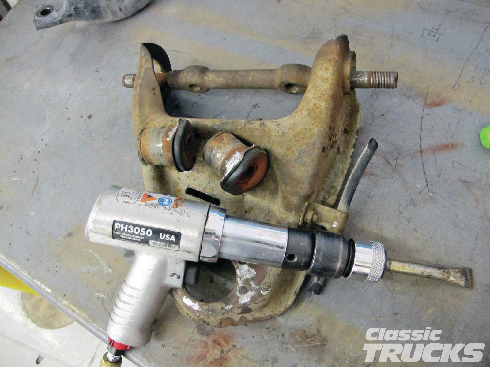 08. I used an air hammer to remove the upper and lower control arm bushings