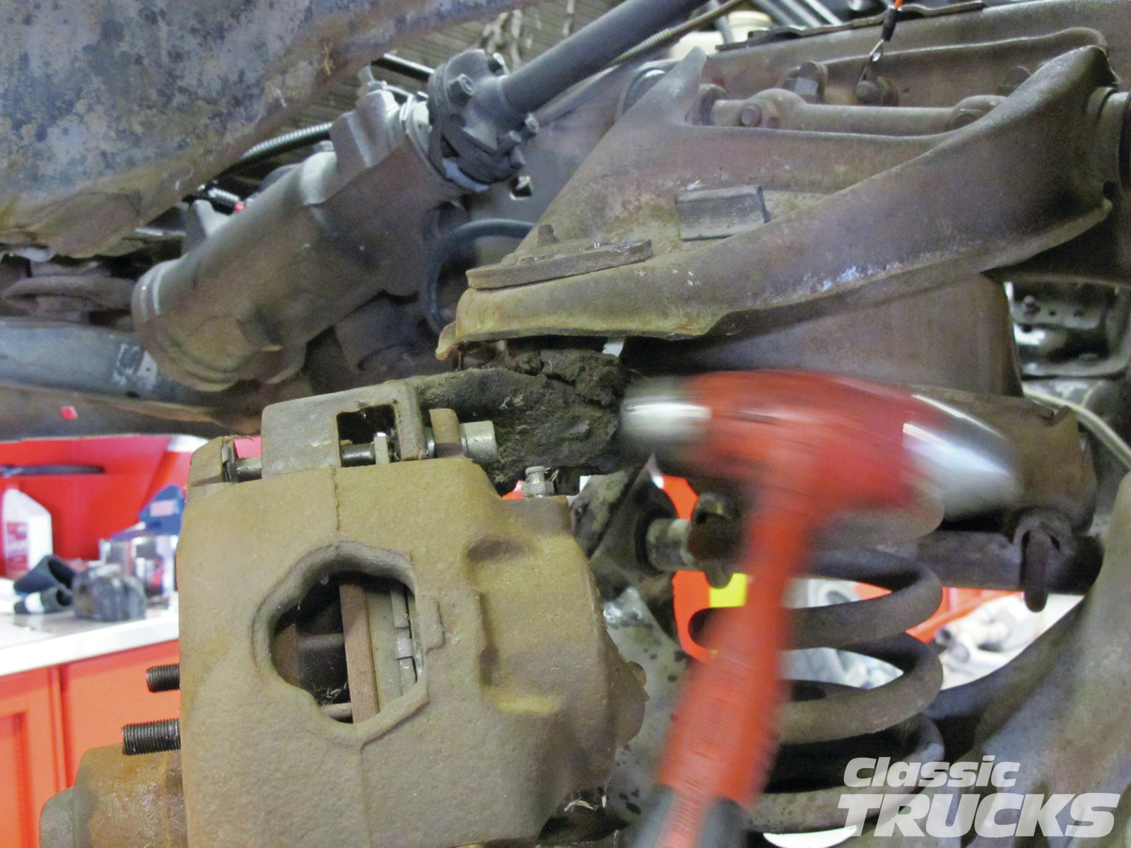 05. One of the hardest parts to remove is the upper and lower control arm tapered joint. They become frozen/rusted in the spindle and have to be shocked out with a hammer. Make sure to hit the spindle side and not the control arm.