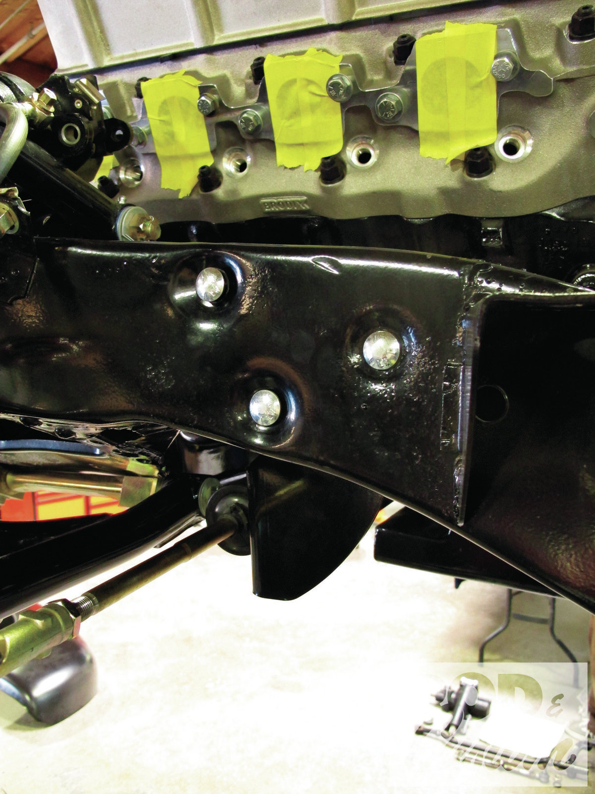11. The three steering box holes are used to mount the bracket on the driver side.