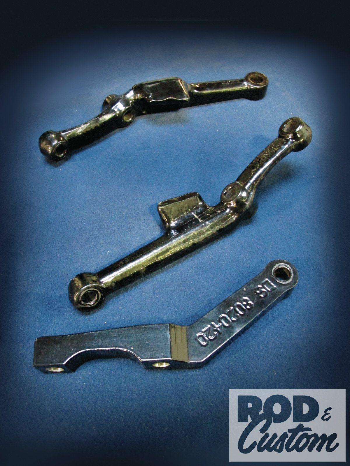 5. Here are the stock steering arms (top) compared to one of the Unisteer versions.