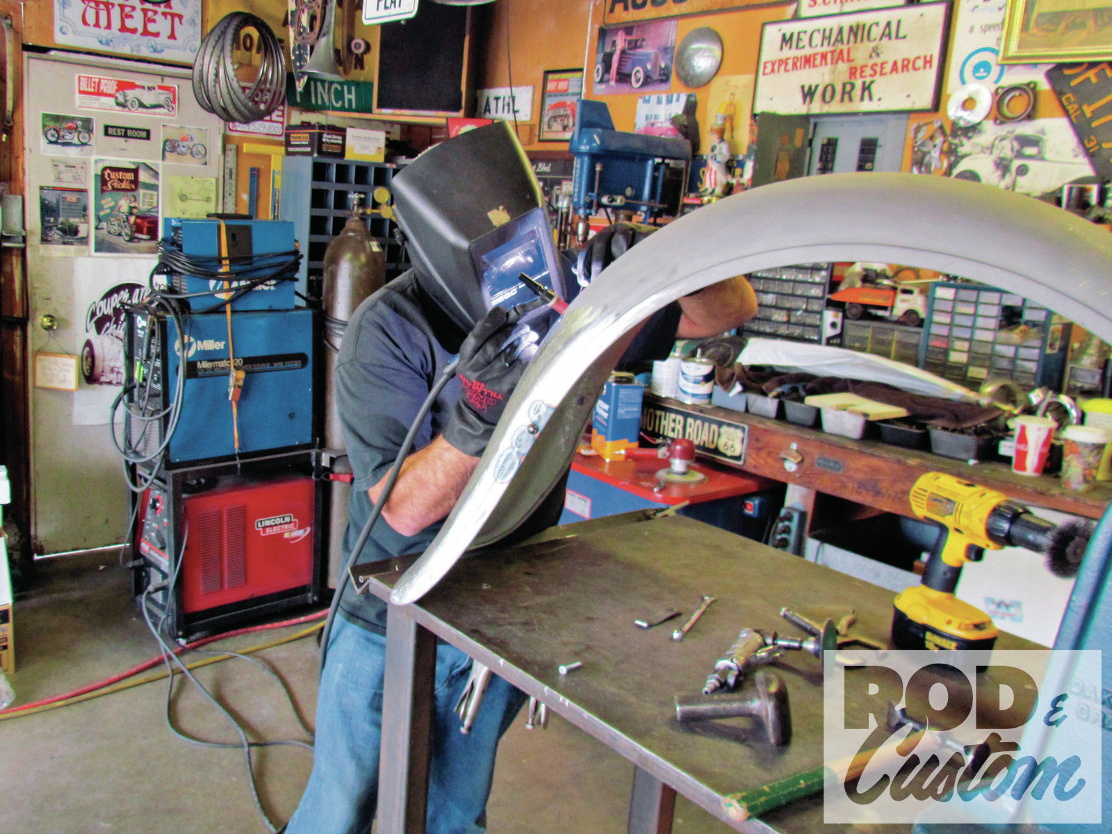 2. Backed by his totem pole of welding equipment, Strube begins to repair the first of several fender fractures.