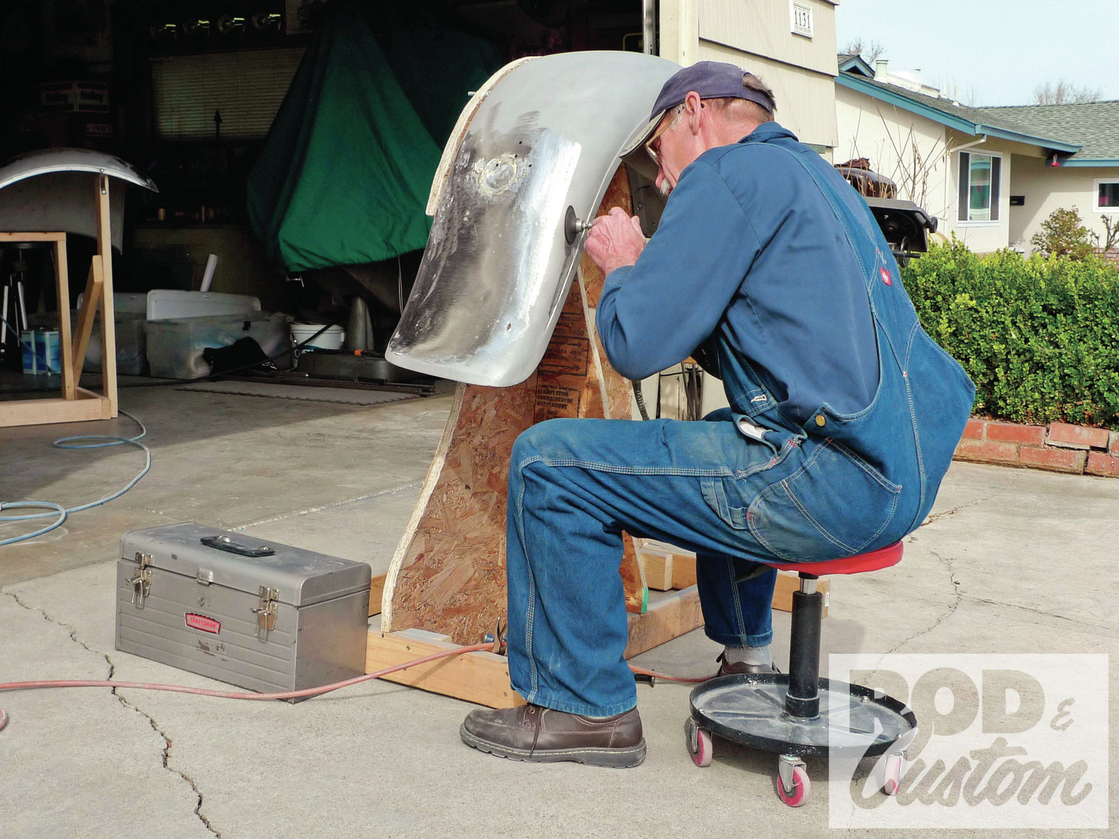 8. By the second day, our metal-working chores were close to done. Here, before filler work begins, Wright makes a quick pass around the fender beads with a Harbor Freight Central Pneumatic angle die grinder. With a 3-inch, 3M Roloc disc attached, the crevice is cleaned quickly.