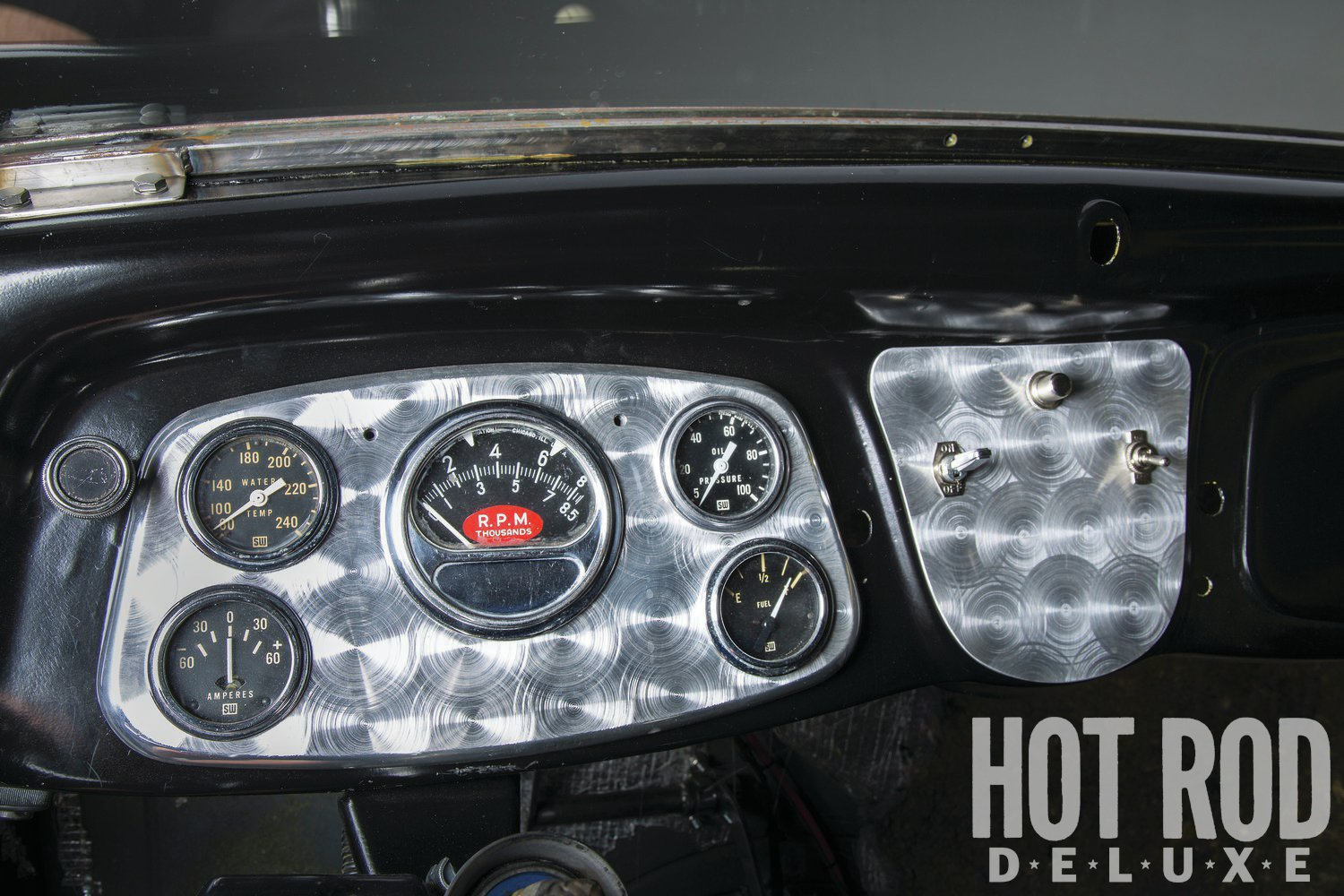 """Gil was somewhat dismissive of the coupe's interior, shrugging his shoulders and describing it as """"nothing special."""" We think it's well turned out, simple, but straightforward and effective. Hurst shifter for the T10 has the right amount of patina; the turned gauge panel is home to vintage Sun tach and Stewart-Warner meters."""