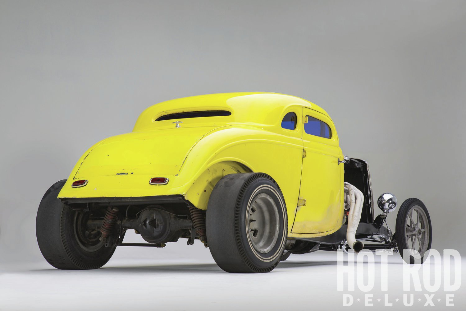"""An early four-bar setup hangs the 9-inch rearend, filled with 3.70 gears and a posi. The 15x9 mags out back are a set made by Romeo Palamides before he founded American Racing, says Gil. The slicks are original early Dragmasters that are """"maybe 50 years old,"""" he says. """"At high speeds they get weird because they're sort of out of balance."""""""