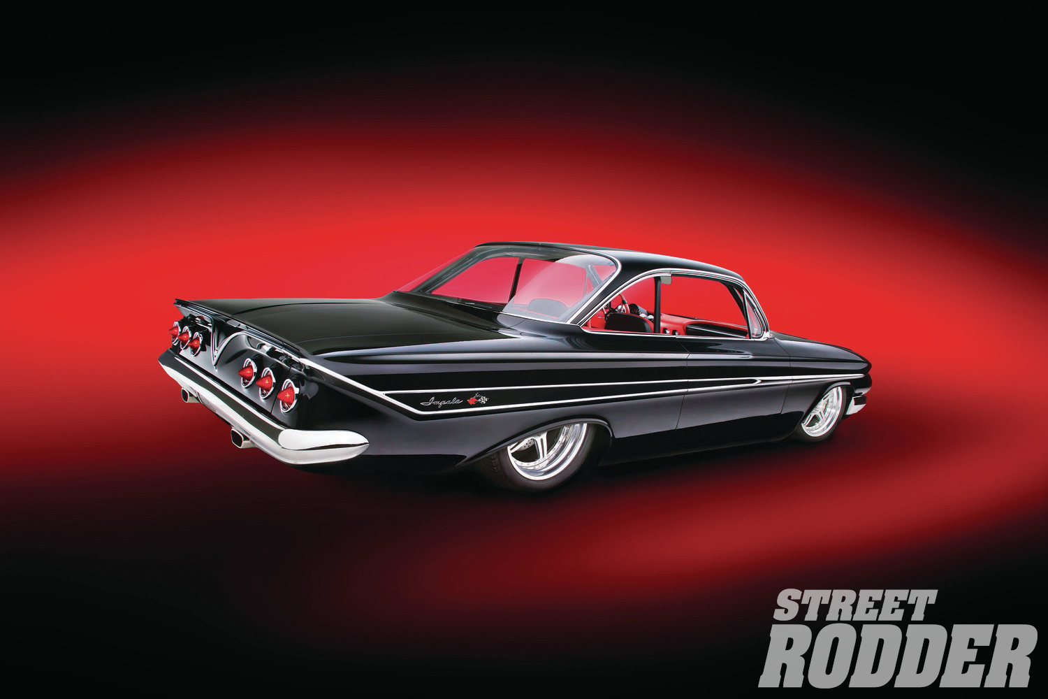 Following illustrations by Alan Childers, Steve Cook Creations fab'd the center console and added the '59 Chevy dash to the interior. The gauge pod in made of graphite (with Dakota Digital providing the custom gauges) and Billet Specialties carved the one-off steering wheel.The black and red leather was expertly stitched and installed by Gabe Lopez's Street Rod Custom Interiors after they reworked the Cerullo bucket seats and built the car's rear bench seating. Their work is so good you hardly notice the car's rollcage.