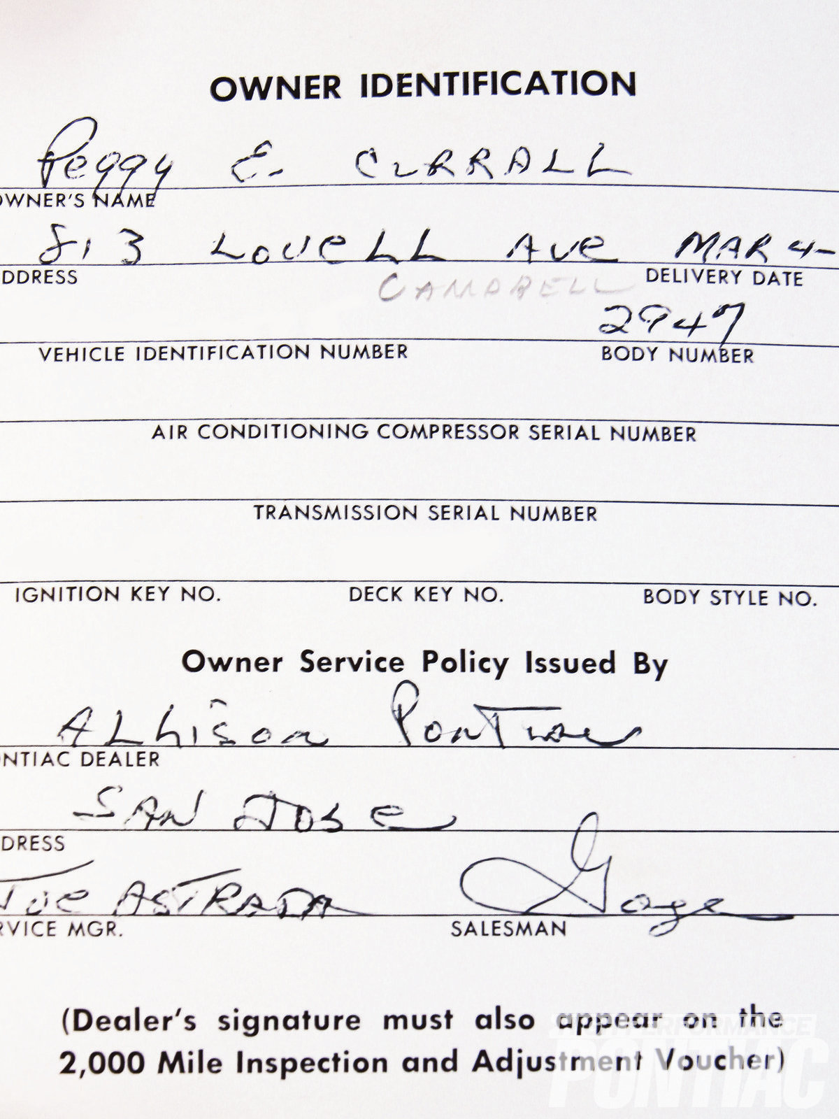 Joe's '62 Grand Prix came with a full array of original paperwork, including this warranty card, which was to be presented at the dealer when the car came in for service. It shows the original owner's name and information written in.