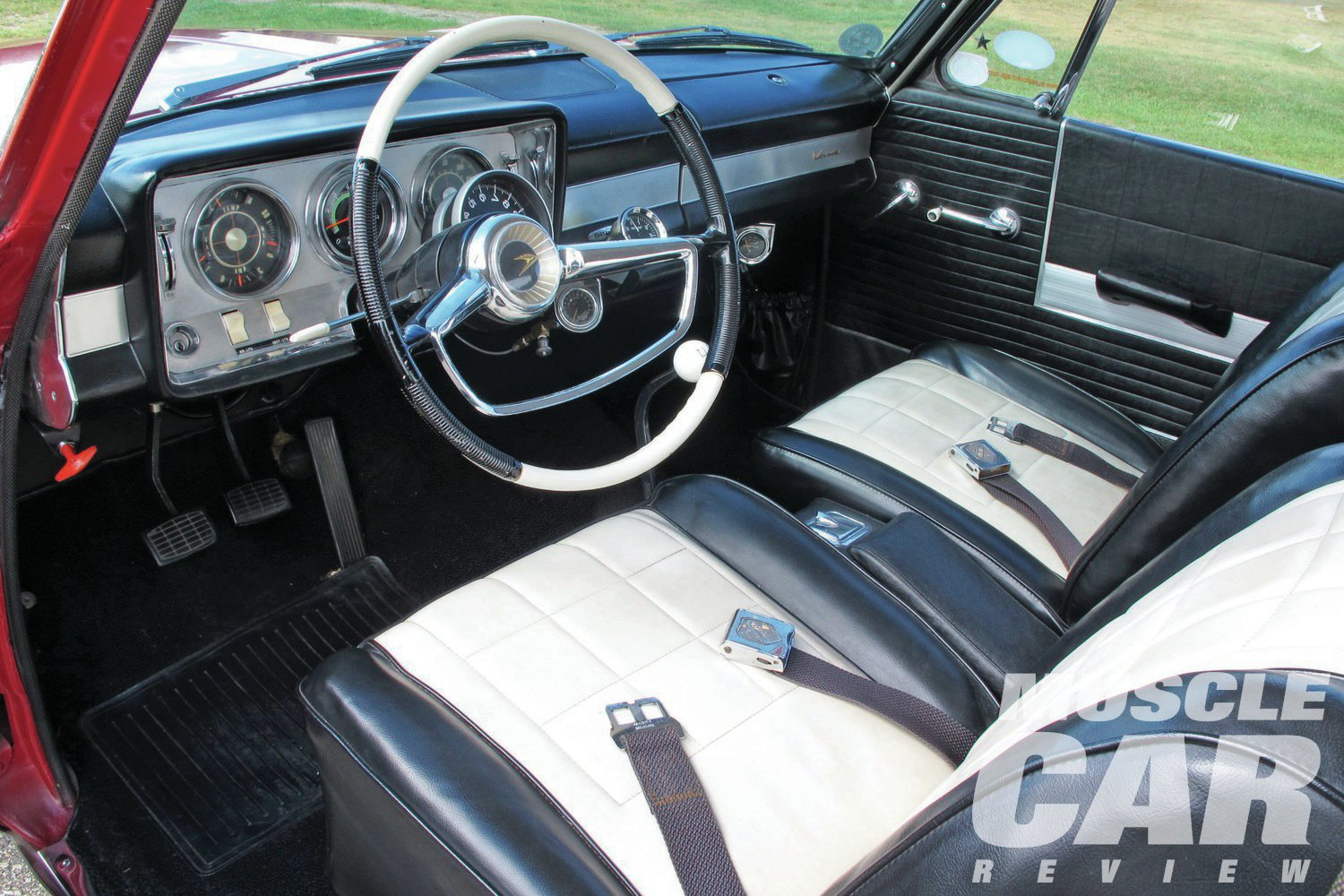 As part of the Custom trim, the Lark's interior is well appointed. Two-tone seats and matching steering wheel add style.
