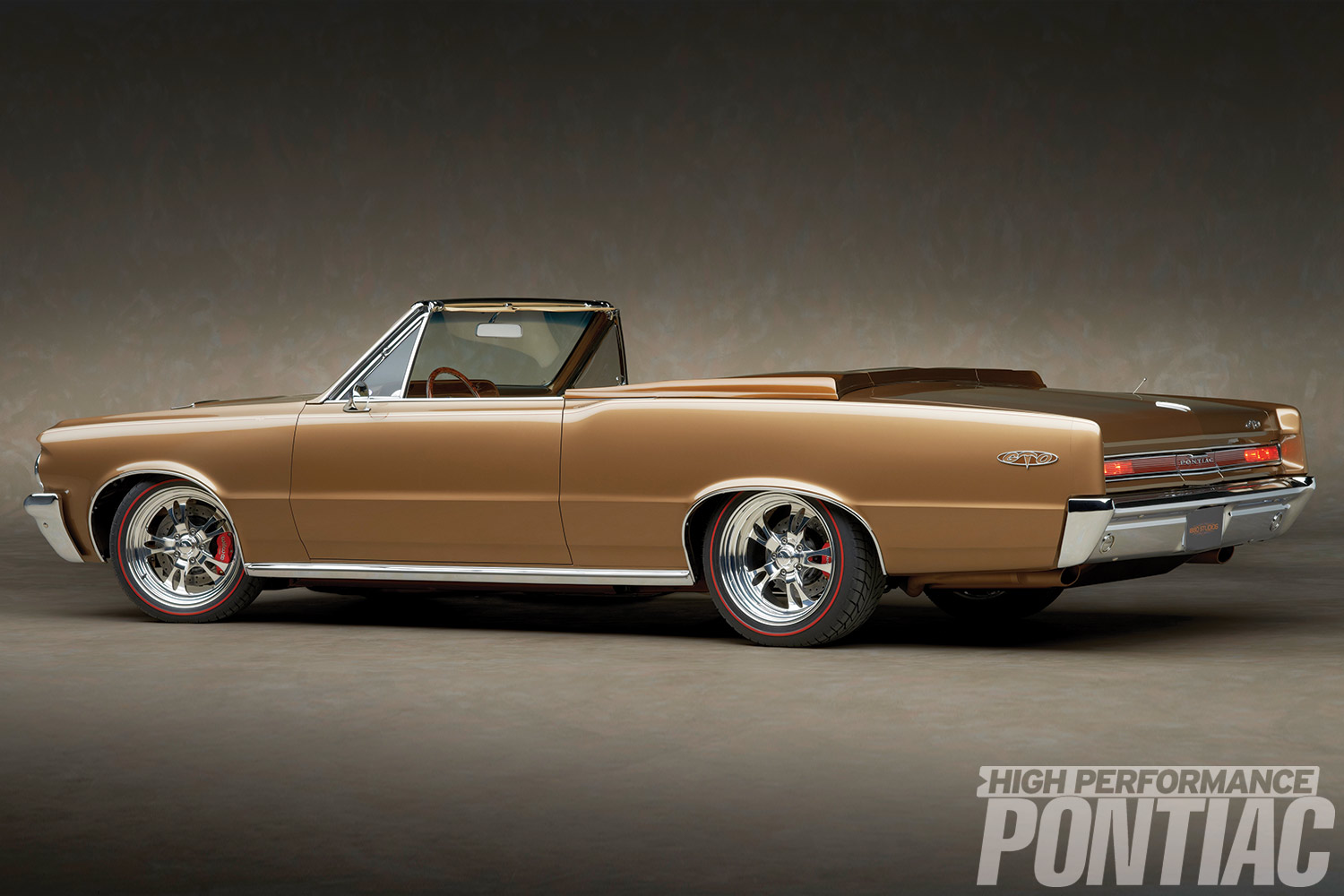Beyond the rolling stock and obvious attention to bright work, the absence of exterior door handles and the unique Mocha Nut color are the only immediate indications that it's not a typical '64 GTO. The GTO's convertible boot is a three-piece fiberglass tonneau cover created by Run Rite Classics. The 2.5-inch exhaust was treated to a unique process that lends to an exhaust system that's completely body colored.