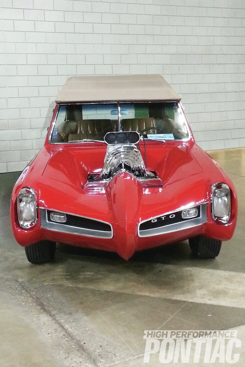 This dead-on front shot gives an interesting view of the exaggerated proportions of the customized GTO. Oddly enough, despite the heavy modifications, the stock '66 GTO grilles are unaltered.