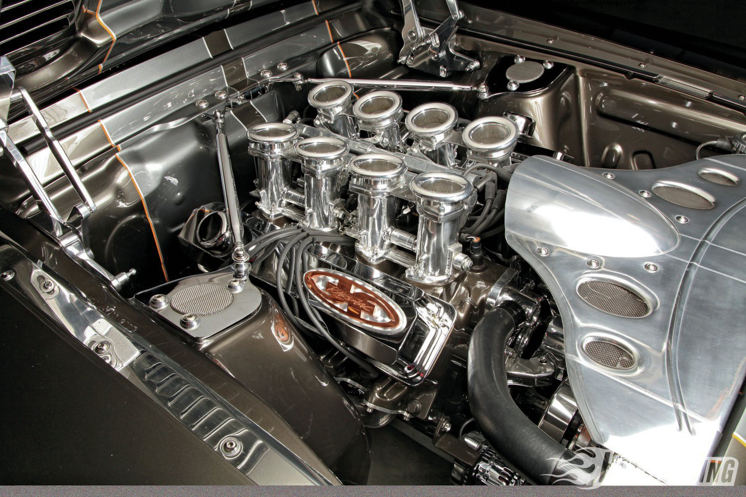 Don't let the dazzle fool you; beneath that paint and chrome lurks 427 healthy cubic inches of side-oiler power, a Tremec five-speed transmission, and Total Control Products suspension fore and aft. If Gordon Phillips' Shelby is familiar to you, it's because we mentioned it in our 2012 SEMA Show coverage in the Mar. '13 issue of PHR.