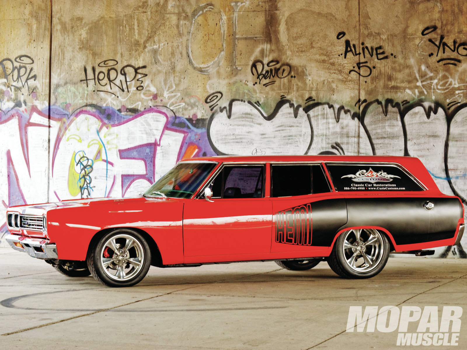 Rare-these-days Satellite wagon was built as a Road Runner and serves as the daily-drivable parts hauler for Cuzie's Customs, and is a rolling billboard for the shop, too. BFG-shod Billet Specialties rims fill the fenderwells and highlight the Sikkens Viper Red/black color scheme.