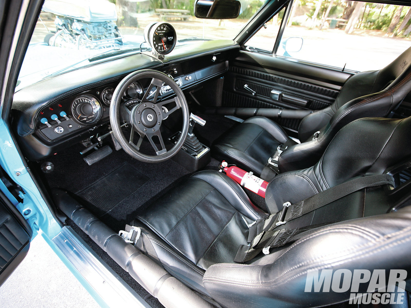 Summit Sport seats sit inside a full rollcage, and atop a reproduction carpet from YearOne. 150-mph speedometer was a 1970-only Swinger 340 feature.