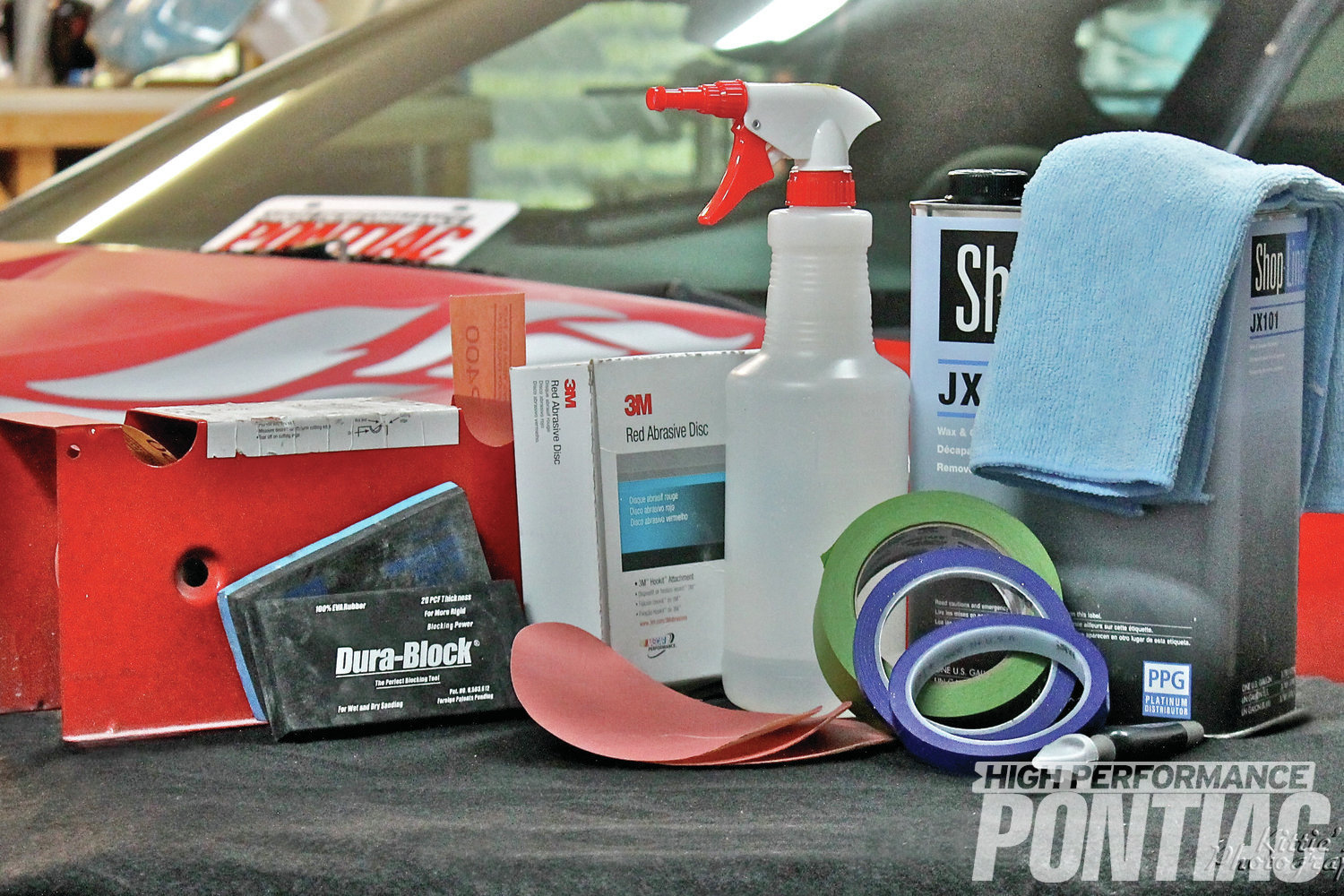 2 Superior Overlay Systems cleaned and prepped the surface to be treated using these common automotive detailing products, such as a block-sander, 800-grit wet and dry sandpapers, a spray bottle with a dish soap/water mixture, and wax and grease remover.