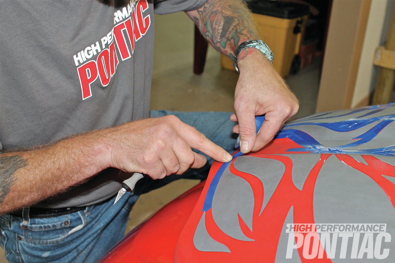 4 Using automotive vinyl, he masked off the area where GlowMax will be applied.
