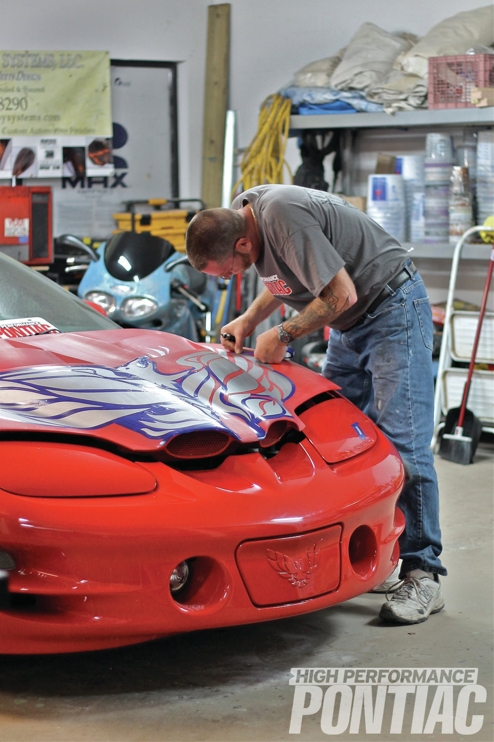 """5 There's only one wing and the chicken """"scream"""" to go and the masking will be done! Some masking jobs are easier than others. Since this hood bird is highly detailed, this step took Mark one full day. """"Most other Pontiac decal kits, like Judge stripes, would take much less time to mask,"""" Mark says. """"In contrast, masking off a Special Edition Second-Gen Bandit, including all the pinstriping, would take considerably longer."""""""