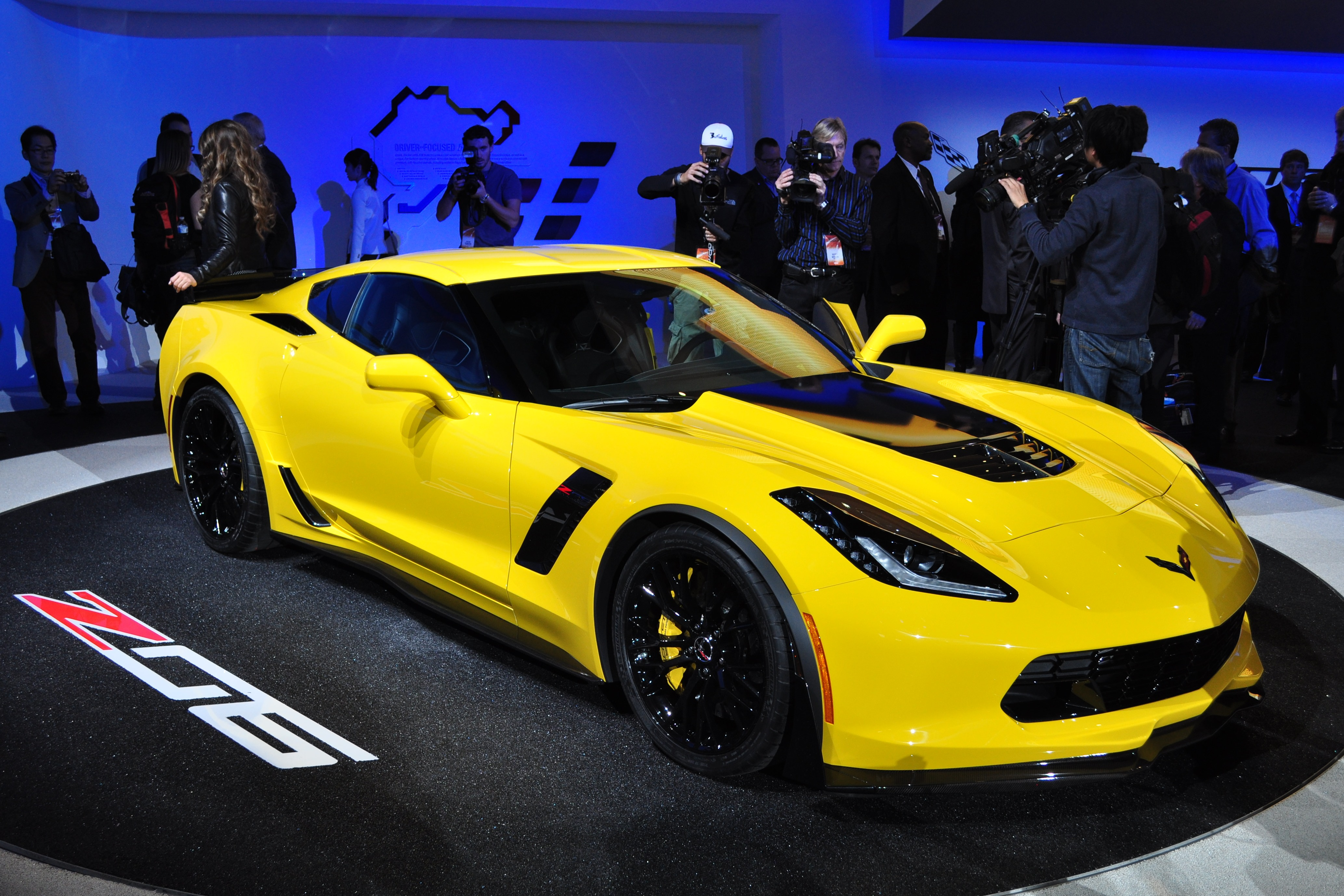 Visual identifiers on the Z06 include fender flares, larger cooling vents, and a big fat hood bump to clear the blower.