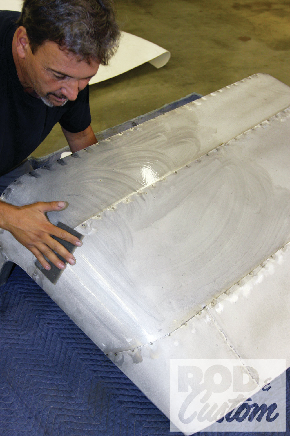 2. The roof was prepped first using an 80-grit disc on a DA sander followed by a Scotch-Brite and degreaser. Note the screw heads have been ground down so as not to be visible through the canvas and foam padding.