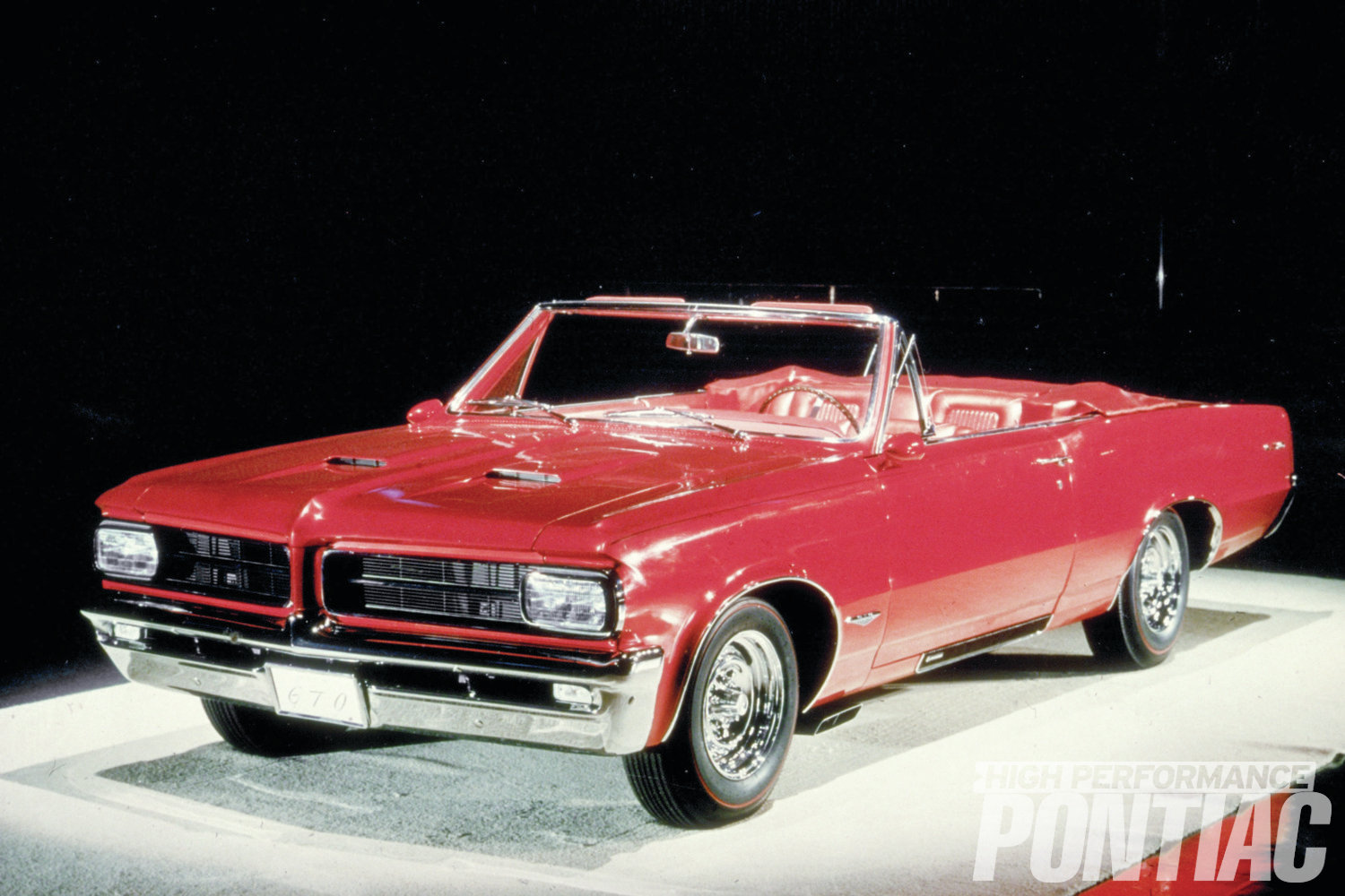 The Flamme was the first GTO show car that Pontiac ever displayed. Painted a brilliant red with a matching red interior, the GTO had many custom touches in vogue back then, including rectangular Cibie headlamps, chrome reverse wheels, and exhaust ports that exited just behind the front wheels.