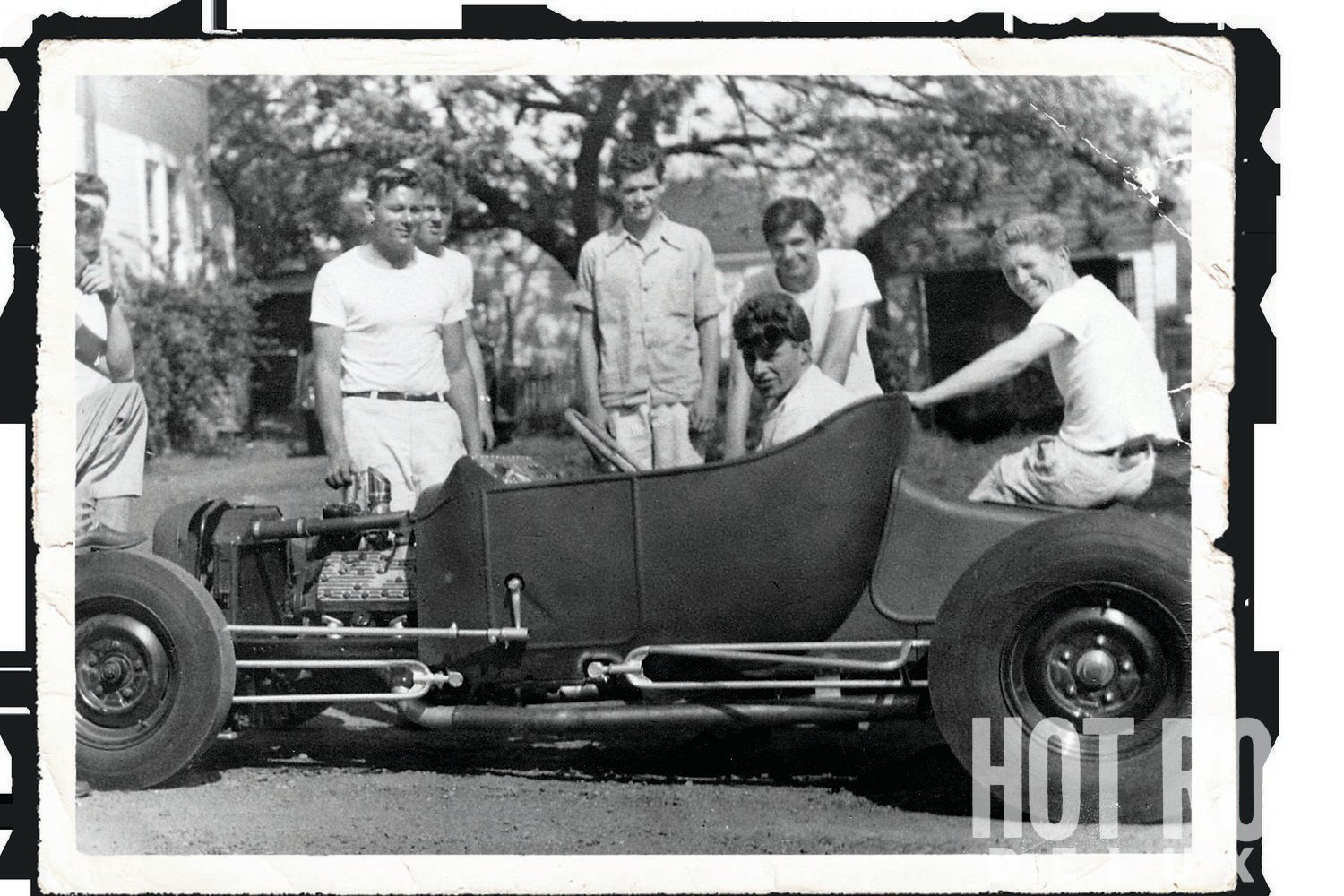 "1949: Jack and his pals fire up his new ""cutting edge"" roadster for the first time. Jack reused the frame from his '27. This car was quite a piece. He machined his own live-axle rearend and rear torsion bars. It weighed in at just over 1,300 pounds. His drivers that season included Bob Gregg, Dick Mclrvin, and Louie Sherman. The car was great on dirt or pavement."
