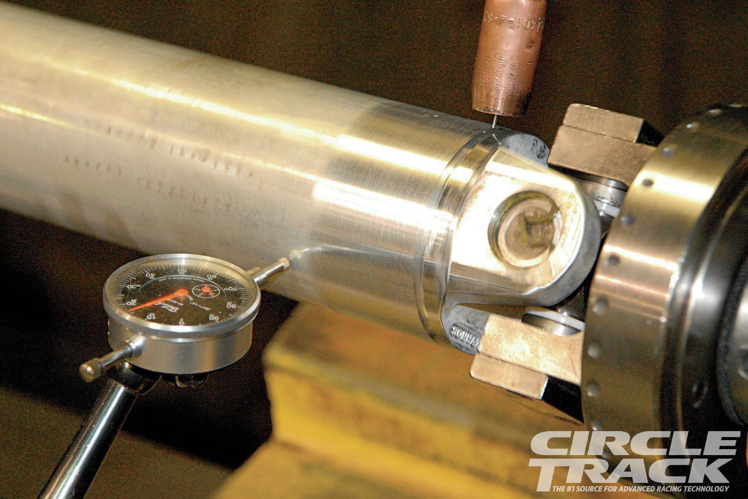 The heat generated from welding the yoke to the tube can warp the driveshaft. It may be only a little—and not enough that it would ever be a problem in an OEM application—but for racing where the rpm is much higher it can be a big deal. Here, Dynotech's technicians monitor runout while welding the yoke to the tube.