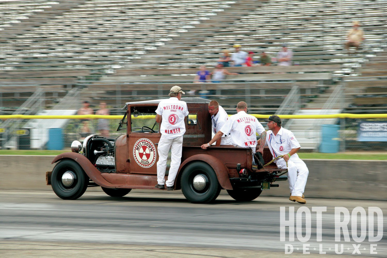 MDA members wore white at the drags to echo the pit crews of racing days past. Here, MDA VP Paul Zielsdorf wheels fellow MDA officers Smokey Moe Peterson, Steve Liberto, Tom Bucek, and Art Zangerle on the way to tow the Koopmeiners & Sons '55s.
