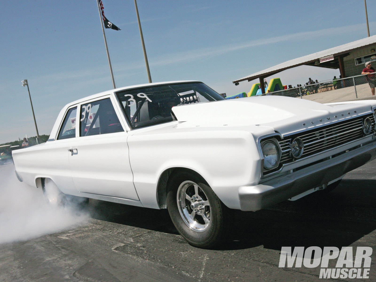 Who says the feature cars are trailer queens? Terry Brown's Belvedere is featured elsewhere in this issue and runs consistent 9-second e.t.'s. Terry's cohort-in-crime, Darren Tedder, was handling the driving duties at the event.