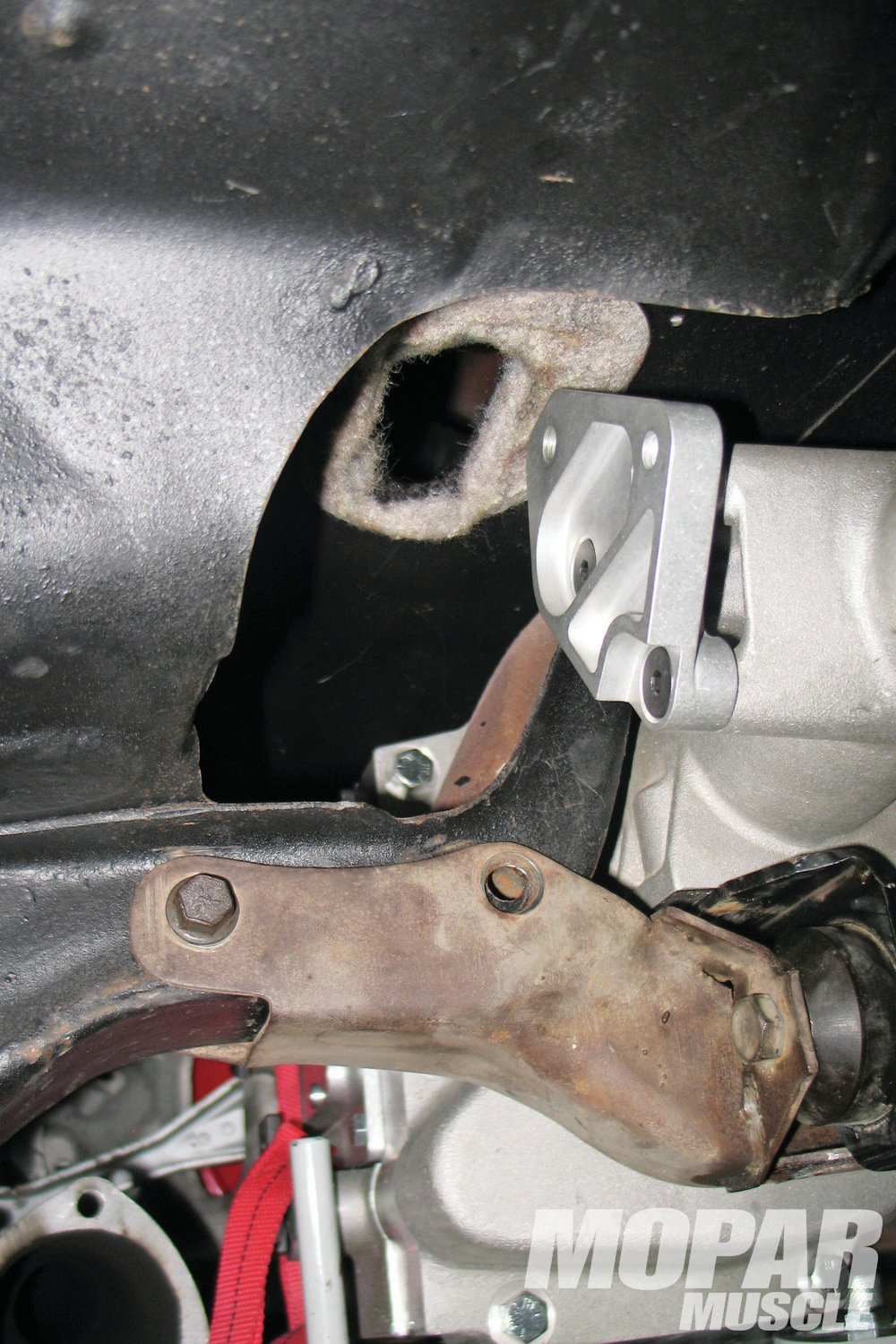 06 A big change that is required for other five speed installs is the relocation of the shifter. Other kits require that a new hole be cut in the floor. As you can see from this image, that is not so with the Passon 855. The shifter location is in the stock, factory location.
