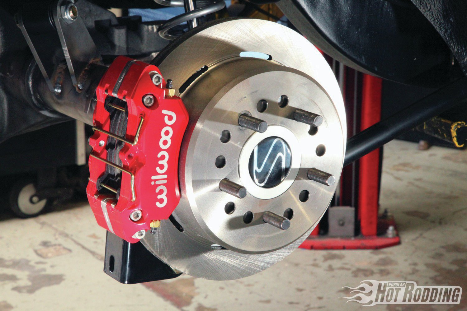 2. Our Strange S60 rearend was delivered with optional Wilwood DynaPro 11-inch discs to match our front Dynalite discs (Strange kit PN B2709WC, $599). These are not in the Strange catalog yet, so tell them PHR sent you. Performance on these four-piston calipers and 11-inch rotors is nearly identical, and well matched to our needs. Note the integral parking brake drum in the rotor hat.