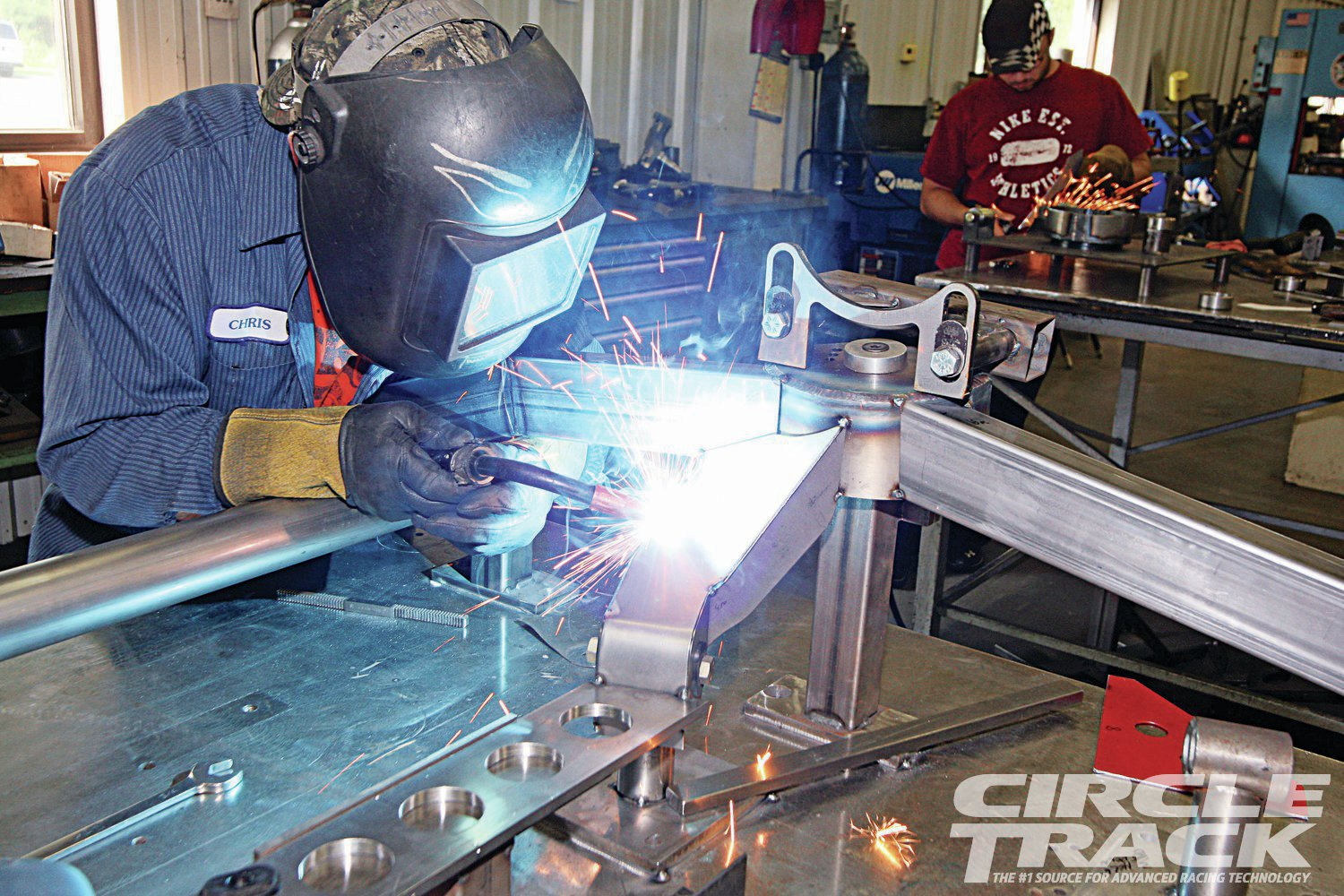 9. Cornett welds up the front clip on a separate jig table. The front clip will be Hess' standard Super Late Model design.