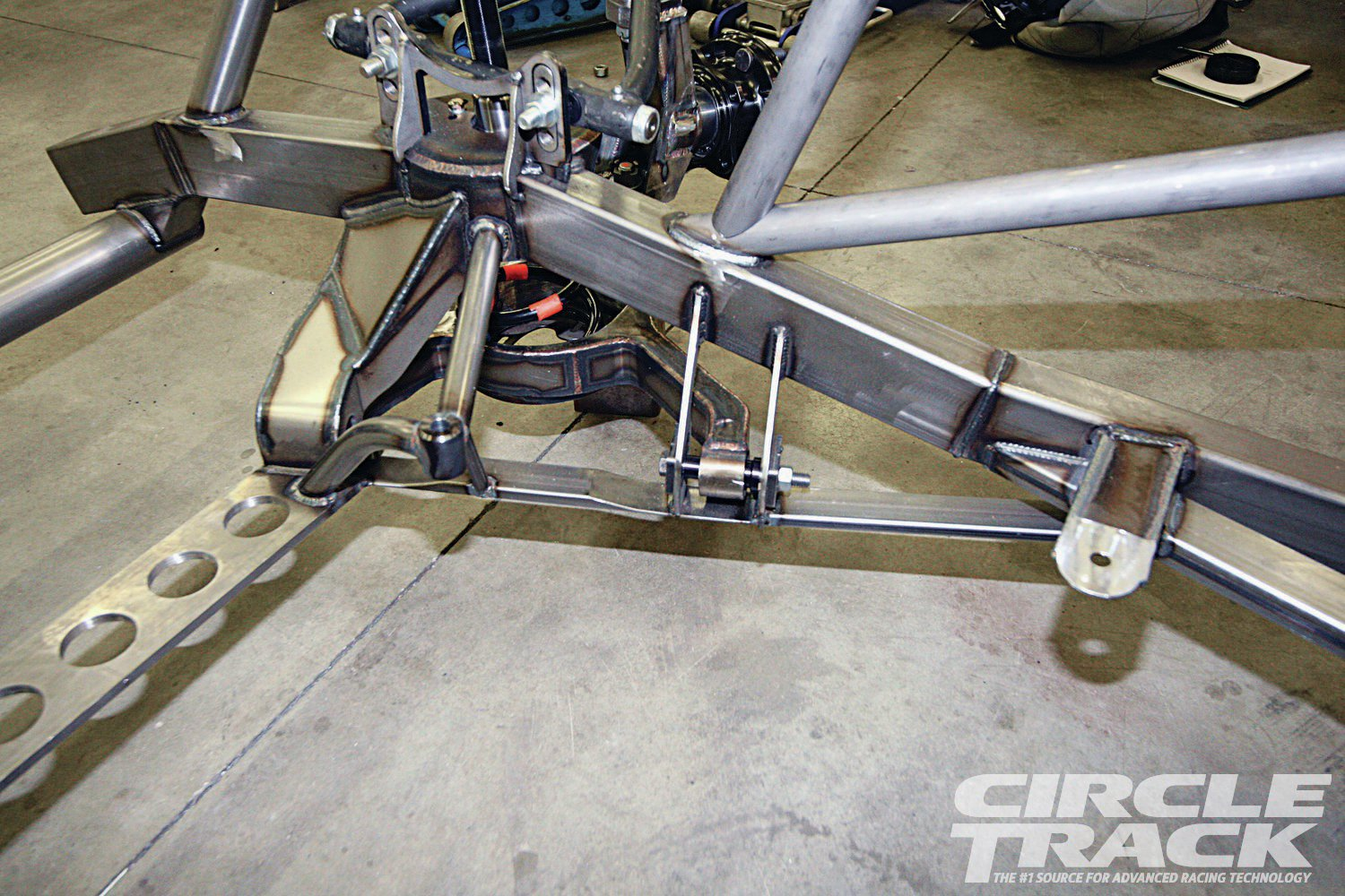25. A look from the other side of the front suspension. You can also see Cornett's completed motor mounts.
