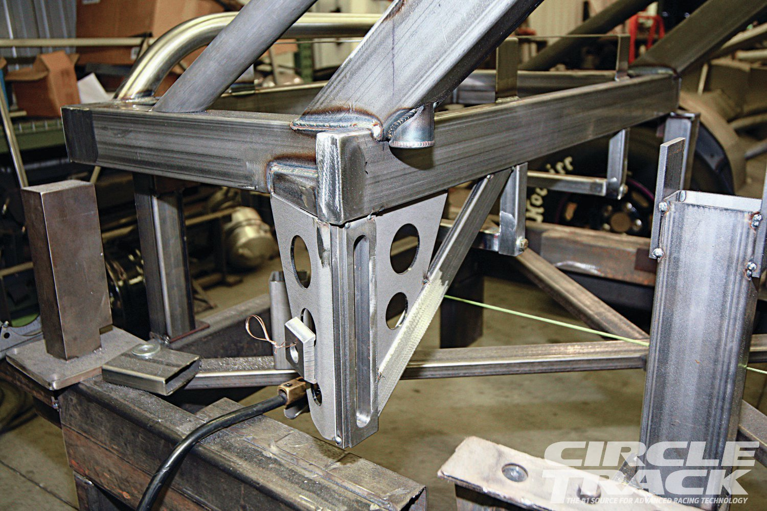 11. The rear Panhard bar mount sees lots of side loading, so it receives plenty of bracing.