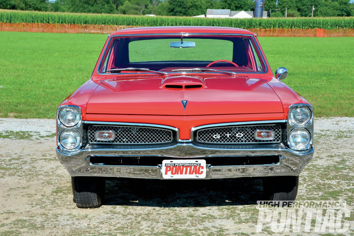 Bright cross-hatch grilles set in blacked-out openings easily identify '67 GTOs. Early Ram Air cars came from the factory with air pans in the trunk and hoodscoops that had to be modified by dealers as part of the new-car-prep process.