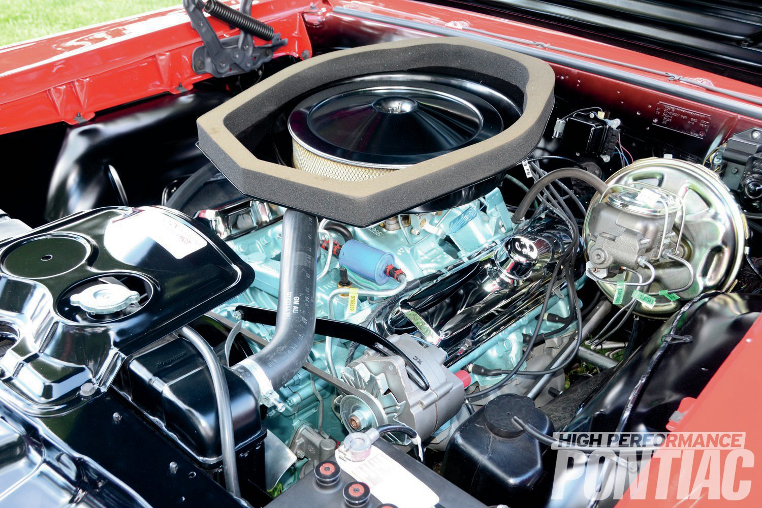 The '67 XS-code Ram Air 400 was rated at the same 360 hp as its '66 three-deuce 389 forbearer, but at a higher 5,400 rpm. Readily available parts from the Royal Pontiac mail-order catalog could extract even more power.