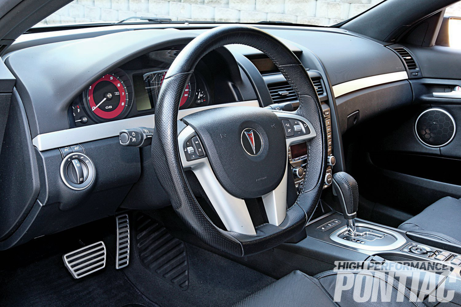 The Onyx leather interior remains completely stock, save for modern Polk Audio speakers.