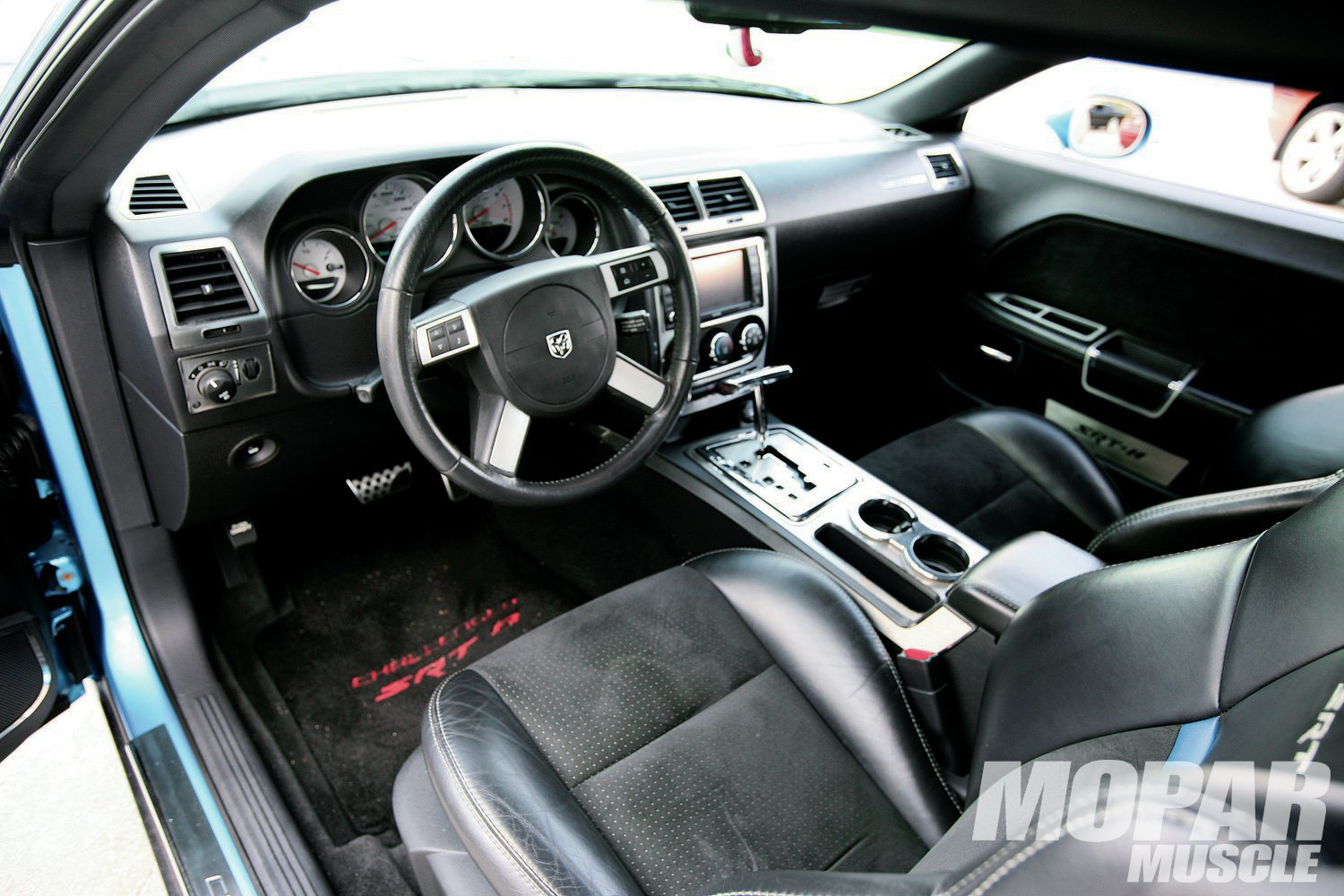 """Interior: Other than the American Car Craft """"SRT8"""" logo plates on the doors, the cabin is just the way it came from Brampton Assembly."""