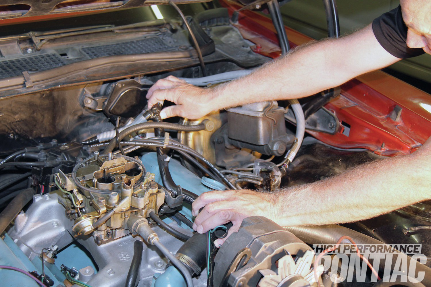 15. The reproduction engine harness fits our Trans Am's 455 just like the original. We set it into place and routed the wires accordingly. Everything is reconnected in the exact same fashion as it was removed.